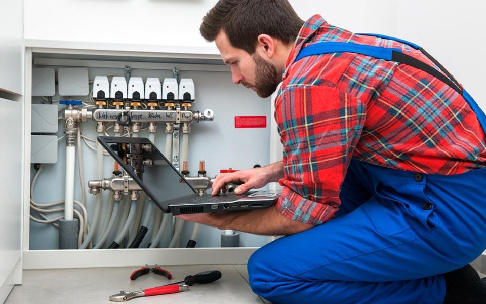 Technician servicing the underfloor heating